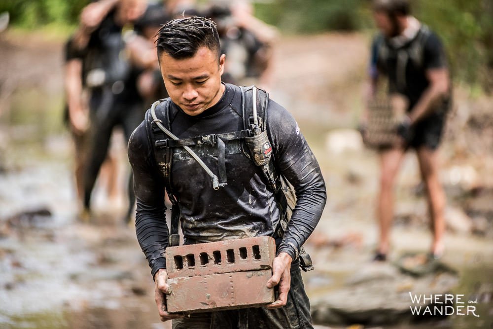 Muddy Brick Carry During Spartan Race 12 Hour Hurricane Heat In Chicago
