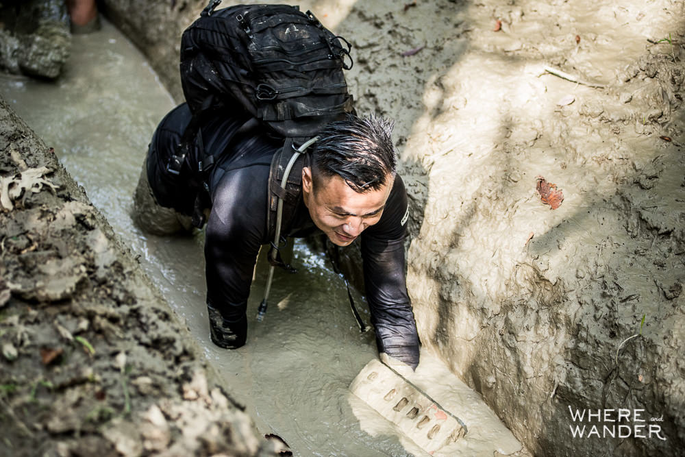 Crawling Through Muddy Trench Pit During Spartan Race 12 Hour Hurricane Heat