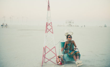 Girl Sitting In Art Installation At Burning Man