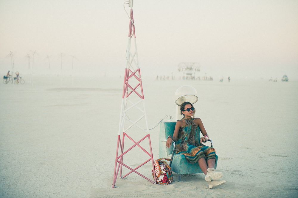 Girl Sitting In Art Installation At Burning Man