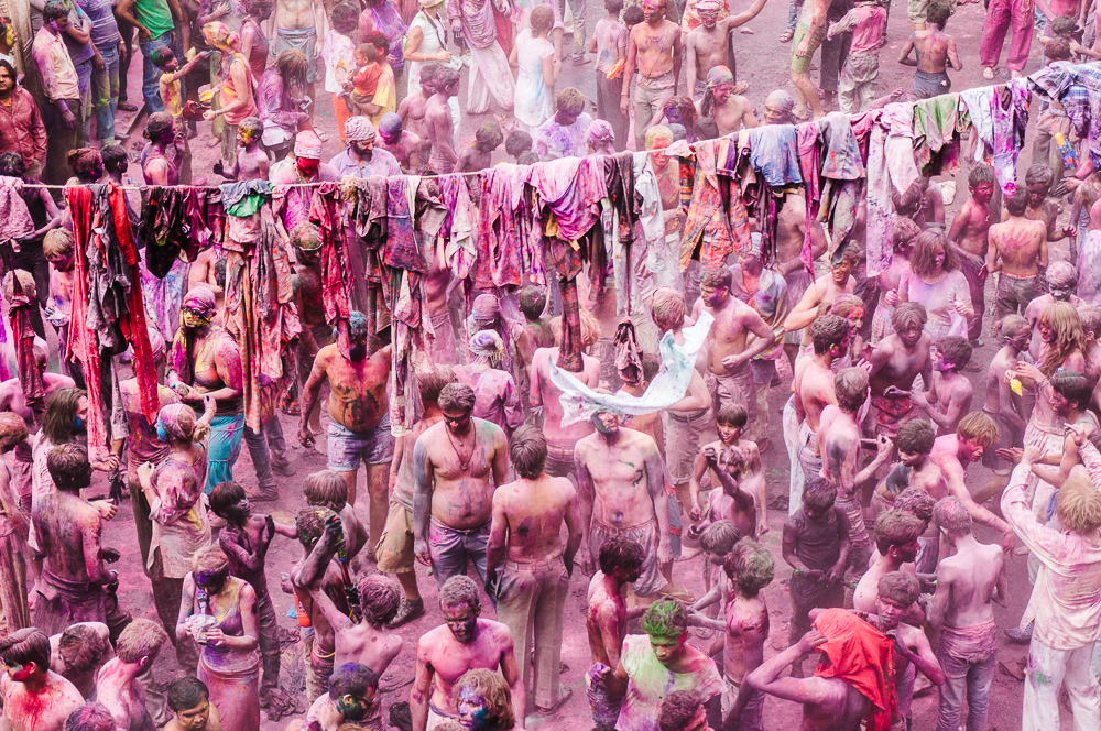 Locals and Tourists Throwing Colored Powders during Holi In Pushkar India