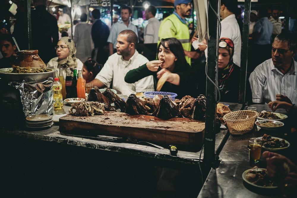 Woman Enjoying Lamb From Stall In Jamaa El Fna