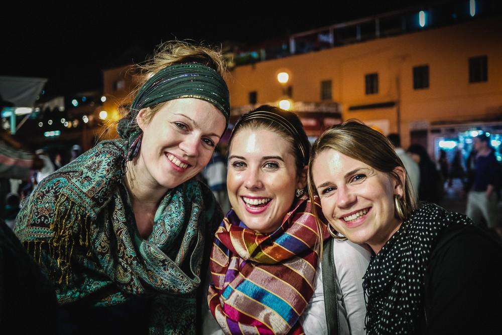 Friends Enjoying Jamaa El Fna Food Stalls