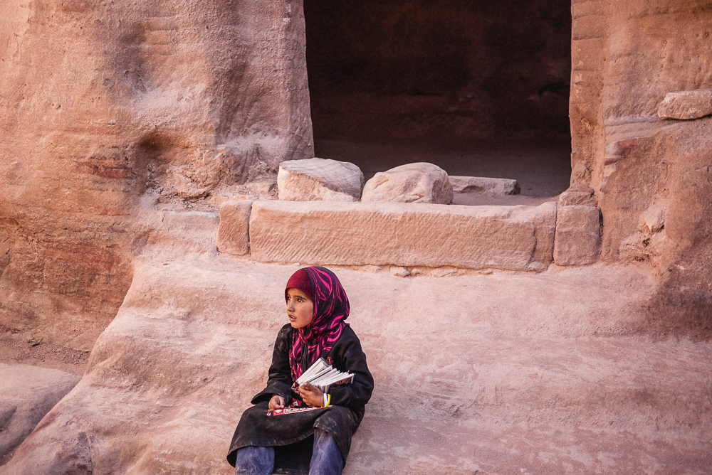Young girl selling books in Petra