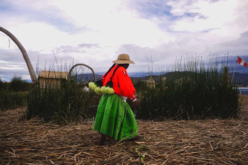 Local Uros Woman On Floating Island In Puno
