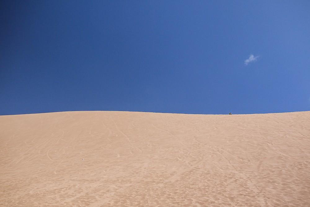 Sandboarding in Valle De La Muerte Sand Dunes