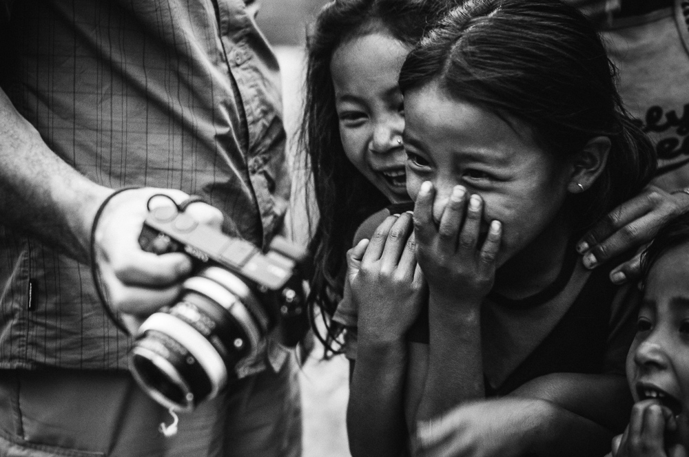 Child Laughing At Camera In Nepal Village Annapurna Circuit