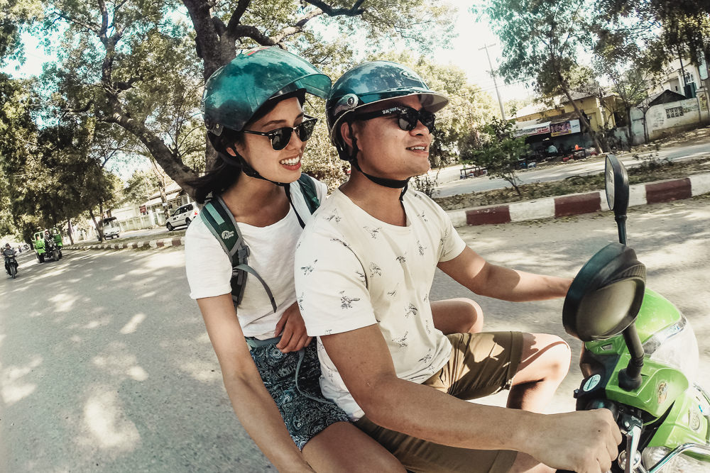 Two people riding ebikes in Bagan