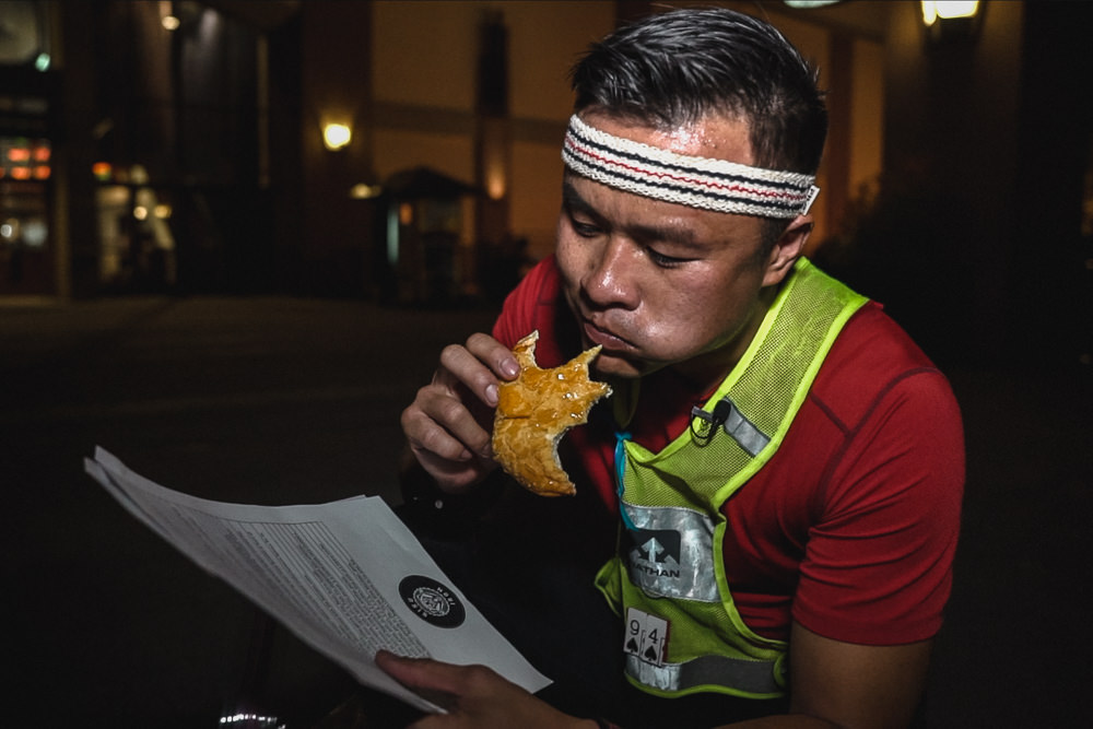 Racer eating pineapple bun wearing fila vintage retro headband