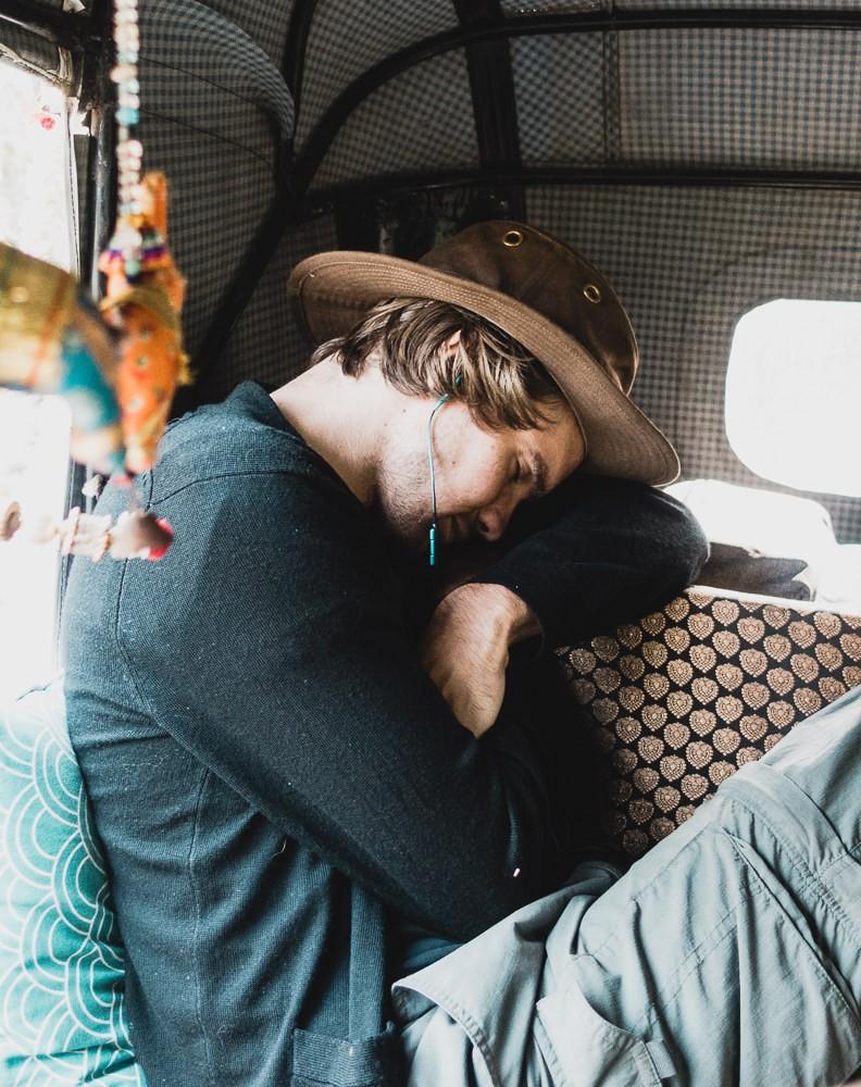 Traveler sleeping in back of rickshaw