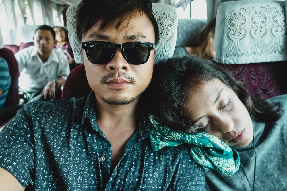 Travelers sleeping on bus