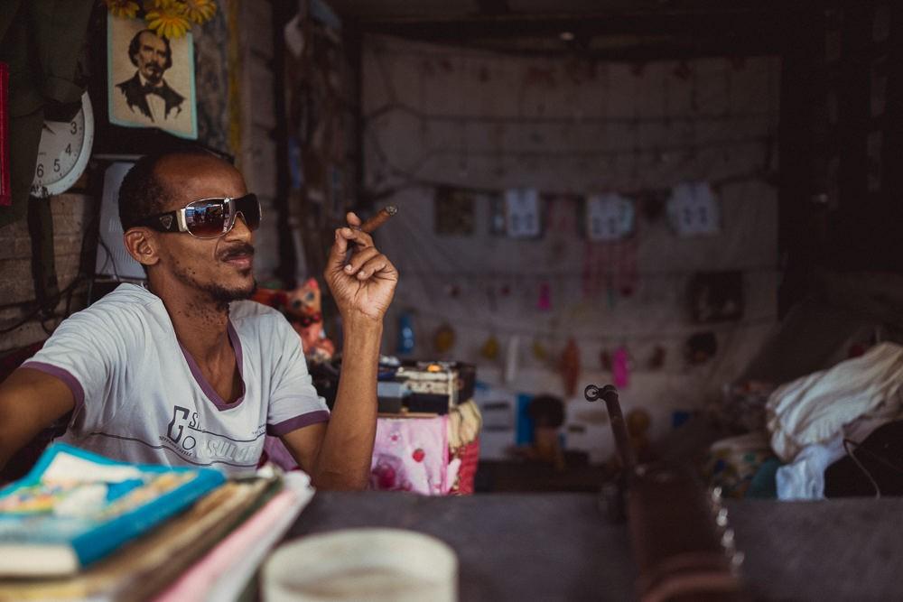Portrait of gun gallery man in Havana