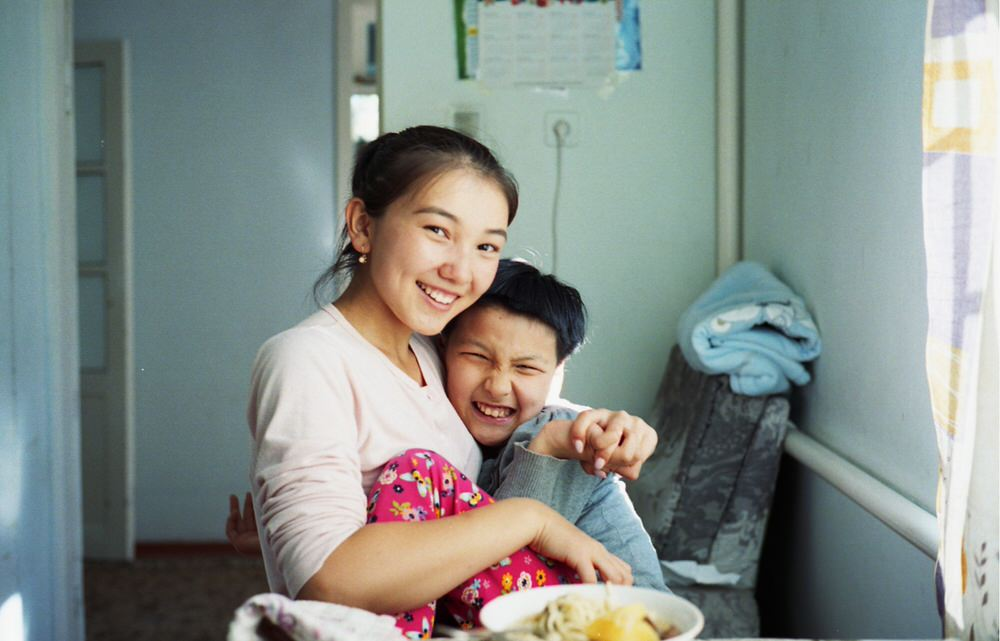 Kyrgyz Girl Sits With Her Disabled Sister