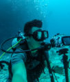 diver shooting underwater timelapse with tripod
