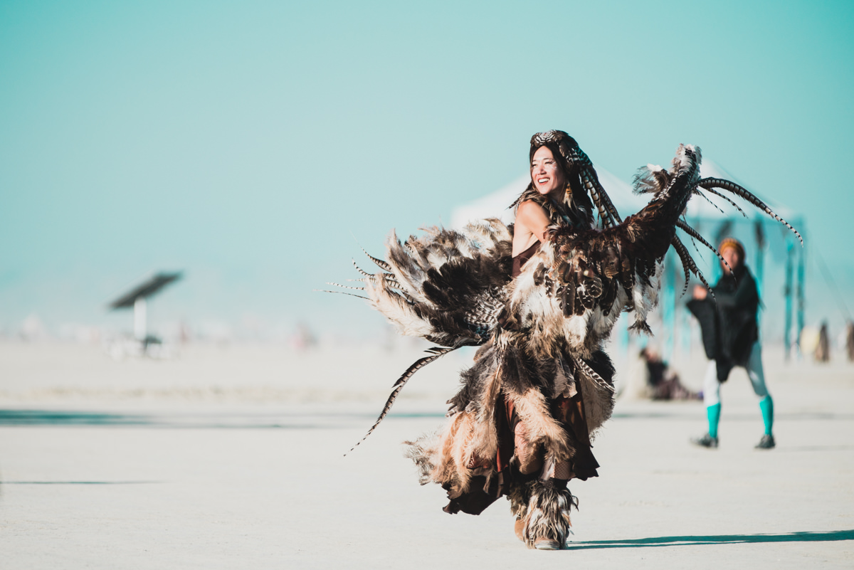 Girl In Feather Burning Man