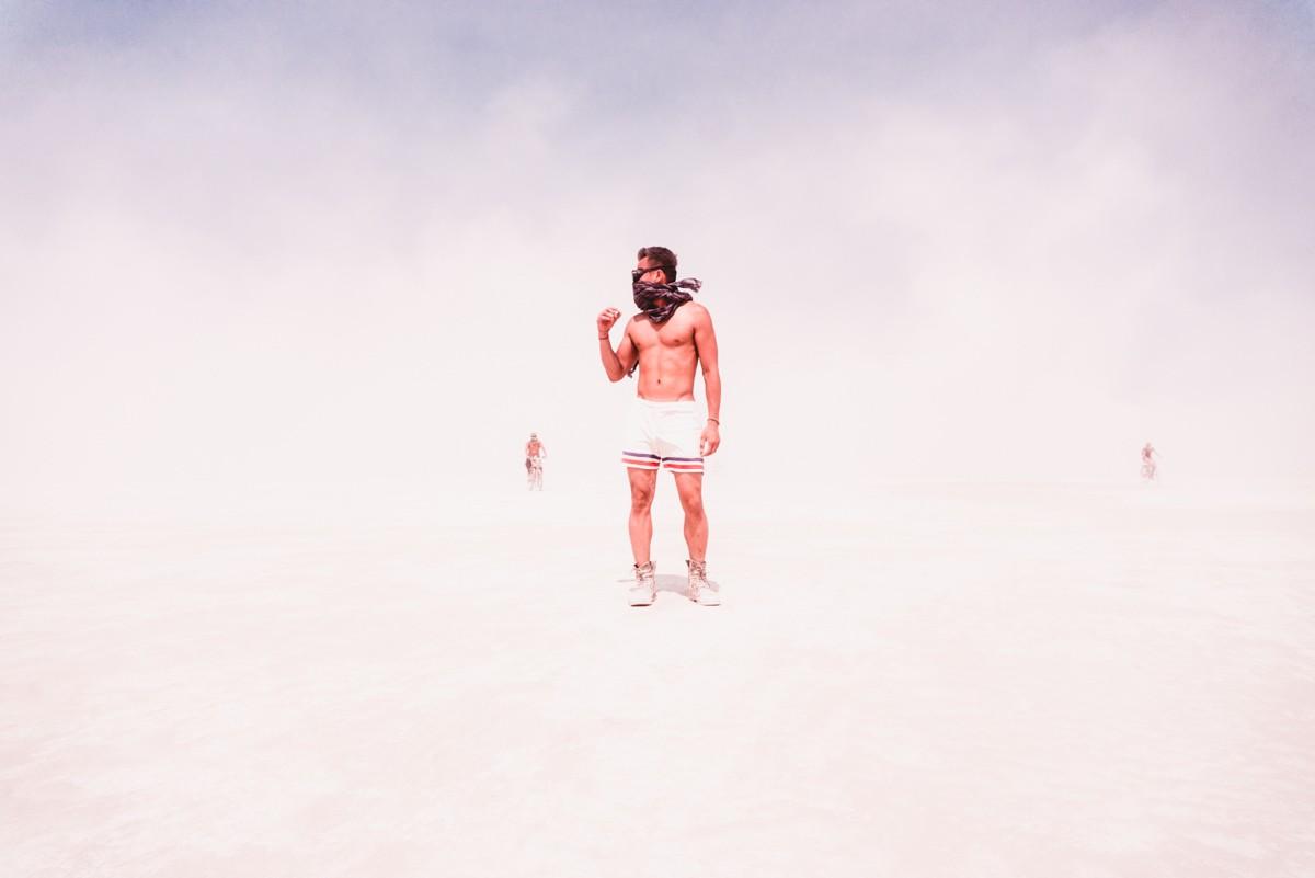 Man Standing At Burning Man In White Out on Playa