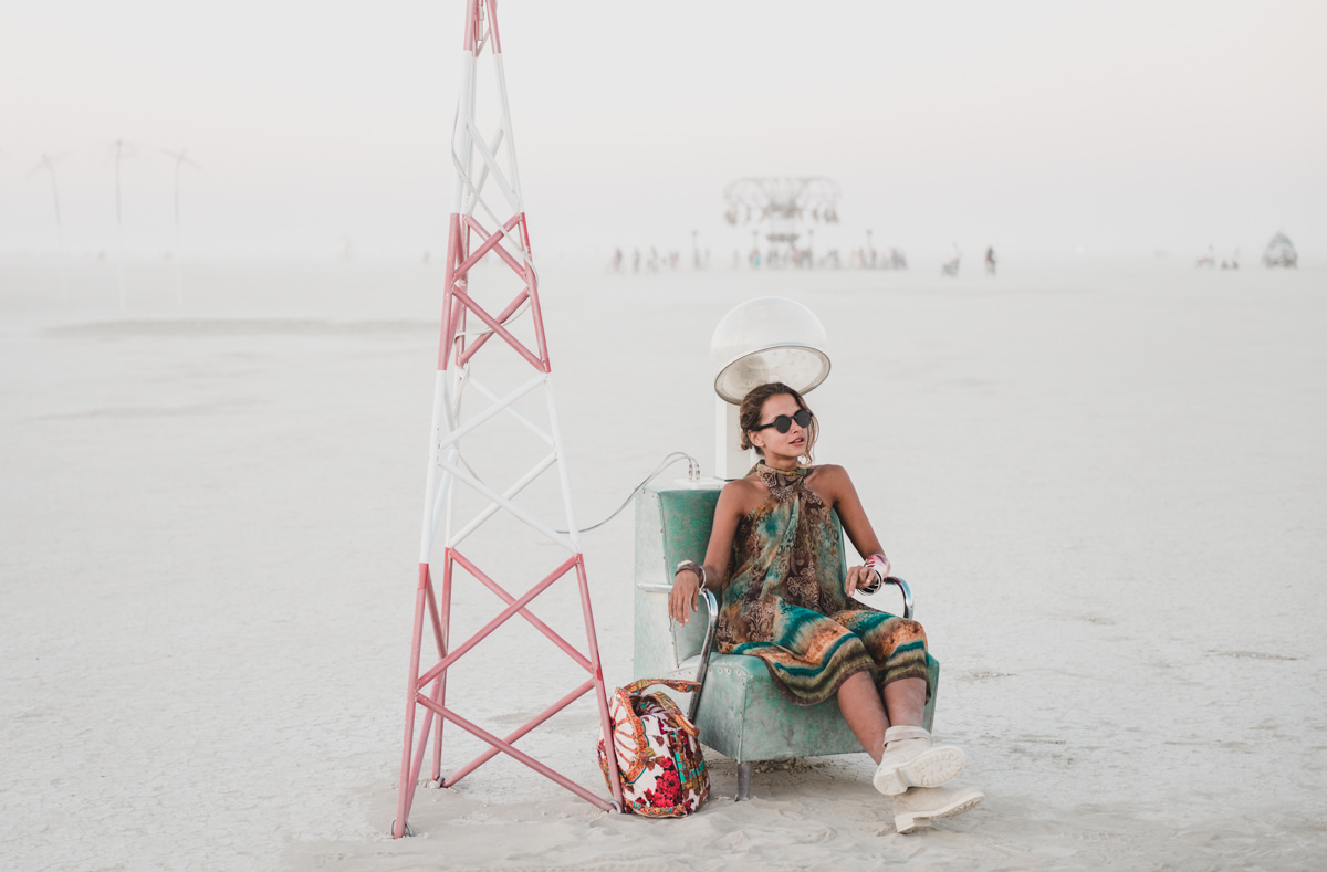 Girl Sitting At Hair Dryer Installation Burning Man Playa